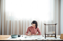 Asian Woman Writing Calligraphy