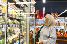 Mature Grey Hair Woman Buying Fruits At Fruit Store