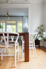 Modern White, Wood, And Brass Dining Room
