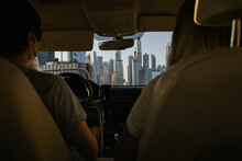 People In The Car With A Cityscape
