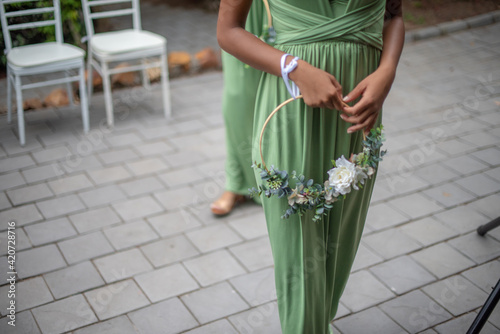 Bridesmaid walking into chapel with flowers Fotobehang