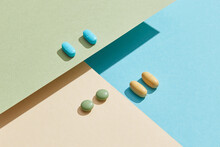 Medical Pills On A Paper Geometric Background.