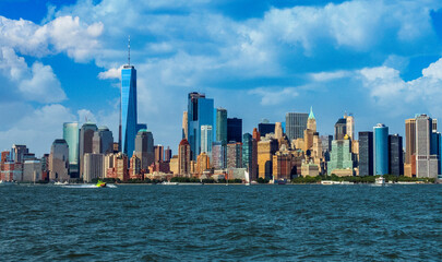 View of Manhattan Skyline, from Liberty State Park in Jersey City, New Jersey. Manhattan is the most densely populated of the five boroughs of New York City.