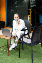 Busines Woman Talking By Phone With Mask At Coffee Shop