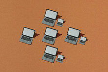 Many Laptop Computers With Shadow From Above