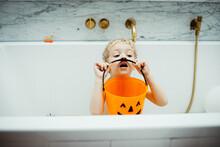 Little Boy Playing In An Halloween Bath