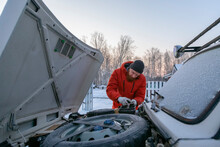 Guy Fixing Car Engine Working In Snowy Rural Yard