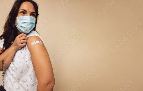 Woman after receiving covid-19 vaccine on her arm