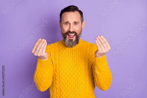 Obraz Photo of displeased man hands fingers show money symbol open mouth yell isolated on violet color background - fototapety do salonu