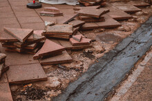 Closeup Of A Destroyed Flagstone Pavement With Discarded Tile Pieces