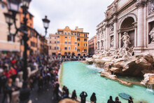 The Trevi Fountain (in Italian: Fontana Di Trevi), A Fountain In The Trevi District In Rome, Italy, Baroque Fountain, With A Crowd Of Tourists Around