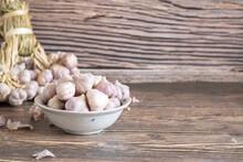 Garlic On Wooden Background, Bunch Of Garlic
