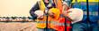 Leinwandbild Motiv Team engineer holding helmet standing in row on site work at train garage, banner cover design.