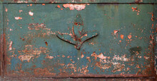 Rusty Ornate Surface With The Decoration Of A Flower - Worn Steampunk Metal Plank With Green Painting Peeling For A Background