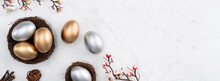 Design Concept Of Golden And Silver Easter Eggs In The Nest With White Plum Flower.