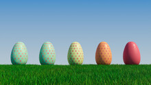 Easter Eggs On A Grass Lawn, With A Clear Blue Sky. Beautiful Red, Aqua And Orange Eggs With Floral Patterns. 3D Render