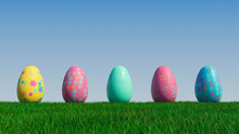 Easter Eggs On A Grass Lawn, With A Clear Blue Sky. Beautiful Blue, Yellow And Pink Eggs With Diamond And Floral Patterns. 3D Render
