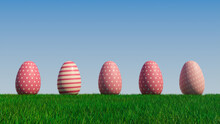 Easter Eggs On A Grass Lawn, With A Clear Blue Sky. Beautiful Pink Eggs With Polka Dot And Striped Patterns. 3D Render