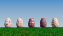 Easter Eggs On A Grass Lawn, With A Clear Blue Sky. Beautiful Purple, And Orange Eggs With Floral, Triangle And Striped Patterns. 3D Render