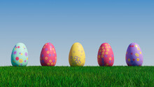 Easter Eggs On A Grass Lawn, With A Clear Blue Sky. Beautiful Purple, Red And Yellow Eggs With Floral And Diamond Patterns. 3D Render
