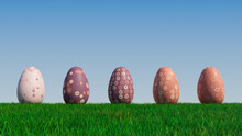 Easter Eggs On A Grass Lawn, With A Clear Blue Sky. Beautiful Purple, And Orange Eggs With Floral, Diamond Patterns. 3D Render
