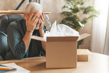 Damaged Parcel Box. Upset Mature Man Closes His Eyes, Returns The Goods To The Store. A Disgruntled Online Shopper. Broken Item, Delivery Problem.