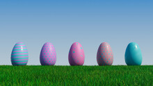 Easter Eggs On A Grass Lawn, With A Clear Blue Sky. Beautiful Pink And Purple Eggs With Striped, Spotted And Floral Patterns. 3D Render