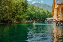 Female On Stand Up Paddle Board On Beautiful Lake