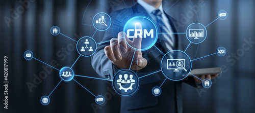 CRM Customer relationship management concept. Businessman pressing button on screen.