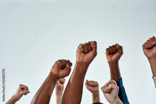 Raised hands of multiracial people clenched into fists Fototapet