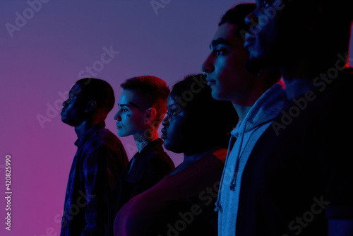 Friendly young multiracial people standing side by side Fototapet