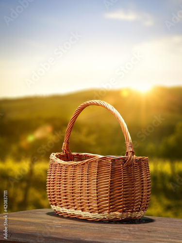 Wooden empty basket and summer time Fototapet