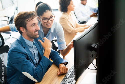 Happy business people having fun and chatting at workplace office