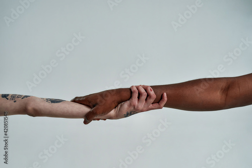 Human hands holding each other in lock shape Wallpaper Mural