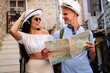 canvas print picture - Summer holiday, dating and tourism concept. Smiling couple with map enjoying travel