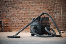 Industrial Vacuum Cleaner On The Dusty Floor Of Construction Site.