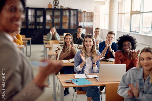Happy university students applauding to their teacher during lecture in the classroom Wallpaper Mural