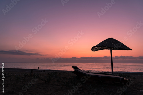 Tablou Canvas A beach in south Turkey with sunbeds and an umbrella, taken right before sunrise