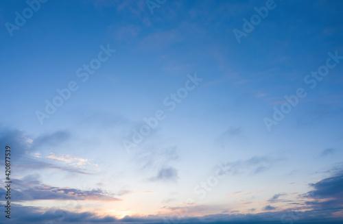 Photo sunrise on blue sky. Blue sky with some clouds