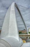 Close up of Gateshead Millennium Bridge, a pedestrian and cyclist tilt bridge spanning the River Tyne in Newcastle, England.