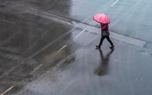 People Walk On Stret Under Rain