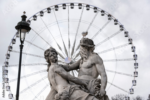 View of statue and Grande Roue ferris wheel, Paris, France
