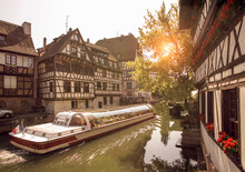 Canal Boat Ferrying Tourists On Canal, Strasbourg, France