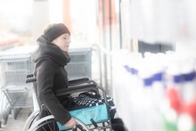 Woman In Wheelchair Going Into Supermarket