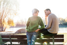 Couple Looking Worried On Park Bench, Strandbad, Mannheim, Germany