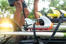 Man Loading Surfboards Onto Car Roof Rack, Pagudpud, Ilocos Norte, Philippines