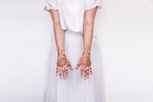 Woman In White Dress With Henna Tattoo On Hands