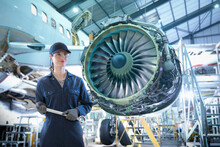 Composite Image Of Female Worker In Aircraft Maintenance Factory