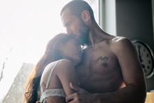 Semi-naked Hipster Couple Bonding At Home