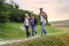Family Of Three Exploring Countryside, Eastbourne, East Sussex, United Kingdom